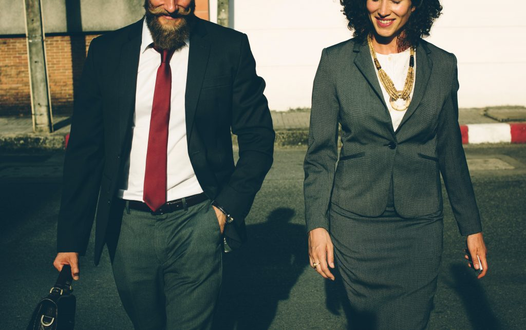 5 Signs That You May Be Smarter Than Your Boss: two associates walking
