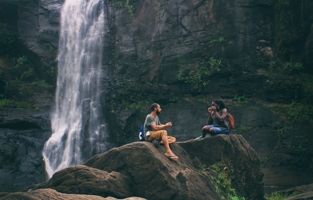 attractive qualities : man and woman at waterfall
